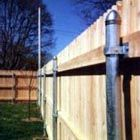 This is genius! Use the old metal posts from a chain link fence to build a wooden privacy fence. MUST REMEMBER THIS!!