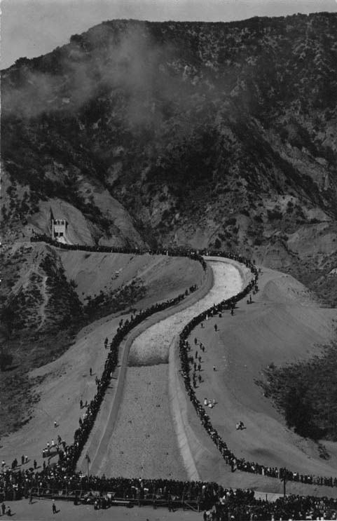 People watch in amazement as the Los Angeles Aqueduct water starts flowing down the cascades into the San Fernando Valley, November 5, 1913.