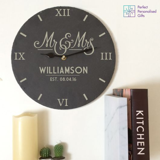 Mr And Mrs Slate Clock.  Personalise this slate clock with two lines of text.  Enter a surname using up to 15 characters and take note that it will appear in uppercase regardless of how you type it in.   You can then enter the special date using a 8 characters.