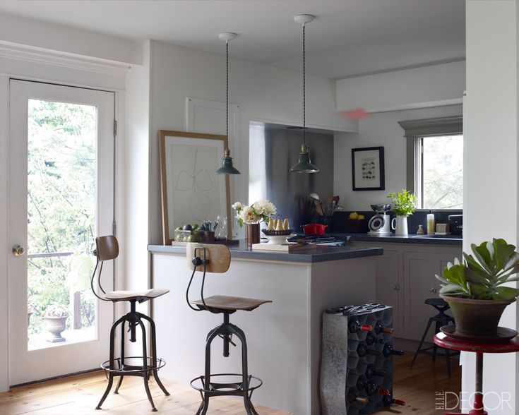 Frank Muytjens of J. Crew Men's Design at Home - ELLE DECOR    {The kitchen's custom-made counter­tops are concrete, and the light fixtures and drafting stools are vintage. Styled by Martin Bourne; Photography by William Waldron}