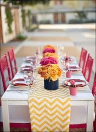 Pink & Orange table setting with orange chevron table runner