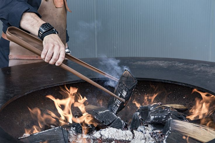 The Buffadoo tongs/poker make it easy to add more wood once the fire is burning well.  #OFYR #theartofoutdoorcooking #grill #poker #tongs #plancha #design #fireplace #outdoor