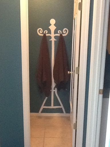 "Very cool ""towel rack"". Paint a coat rack silhouette and add hooks"