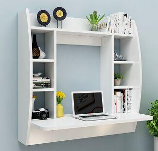 Multifunción escritorio de la computadora estantería en la pared. la mesa contra la pared