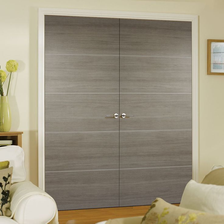 Laminate Santandor Light Grey Door Pair is 1/2 Hour Fire Rated and Prefinished - Lifestyle Image.    #moderndoors #contemporarydoors