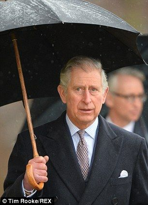 A brolly good time: Prince Charles is patron of the not-for-profit organisation the Pub is the Hub, which he paid a visit to today