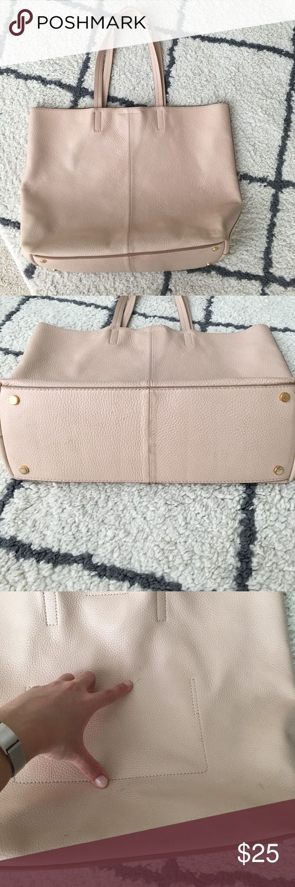"""Banana Republic leather tote Pretty light pink/blush color. Pebbled leather with magnetic button snap. Roomy interior with one small side pocket. Bottom has little """"feet.""""  Approximately 17""""x10""""x5"""" and 9"""" shoulder drop handles.  Definitely got my use out of this- there are some scuffs/marks/stain on inside but still has a lot of life left in it. Banana Republic Bags Totes"""