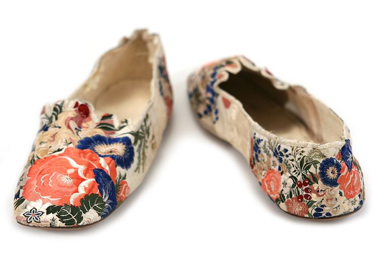 Circa 1850 pair of brocaded ribbon-silk covered ladies shoes of white kid overlaid in colorful silk, Great Britain.