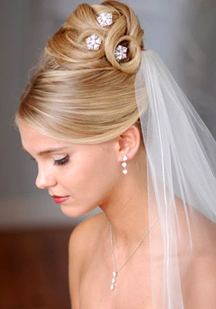 If you have long and thick hair types then you can choose straight or curly hairstyles. Your hairstylist can better suggest you a hairstyle that can suit your natural hair type. Many brides like to add a flower with updos. The color of the flower can be in contrast to the wedding dress. Often brides like to wear a tiara with half up and half down hairstyles. It is best for those who have dreamt of a fairy tale wedding. You can also add hair clips and other fancy jewels that will give you a…