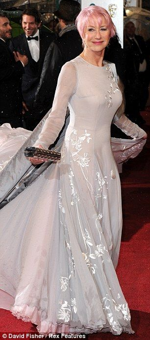 Helen Mirren enjoying the reactions as she showed off her daring new look for the first time at the BAFTA awards.