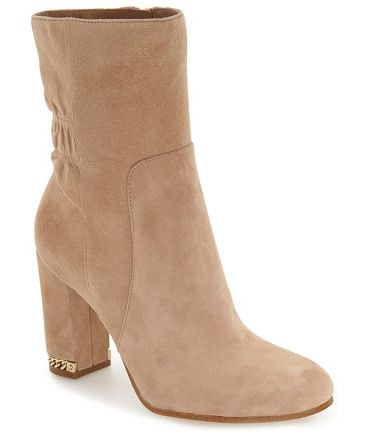 dolores bootie by MICHAEL Michael Kors. A ruched shaft and inset chain detailing at the heel enhance the casual sophistication of a round-toe bootie that's a...