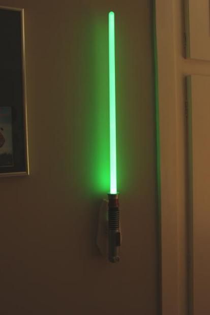 This is the Lightsaber room light for walls.  Also available: Blue or red.  WANT.