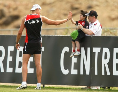 Nick Riewoldt high-fives a young Saint
