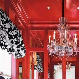 A Chinese Red Lacquered Cabinet Frames Mercury Glass In This Eclectic Dining Room