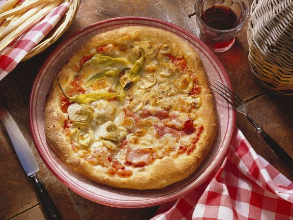 Pizza quattro stagioni ist ein Rezept mit frischen Zutaten aus der Kategorie Fruchtgemüse. Probieren Sie dieses und weitere Rezepte von EAT SMARTER!