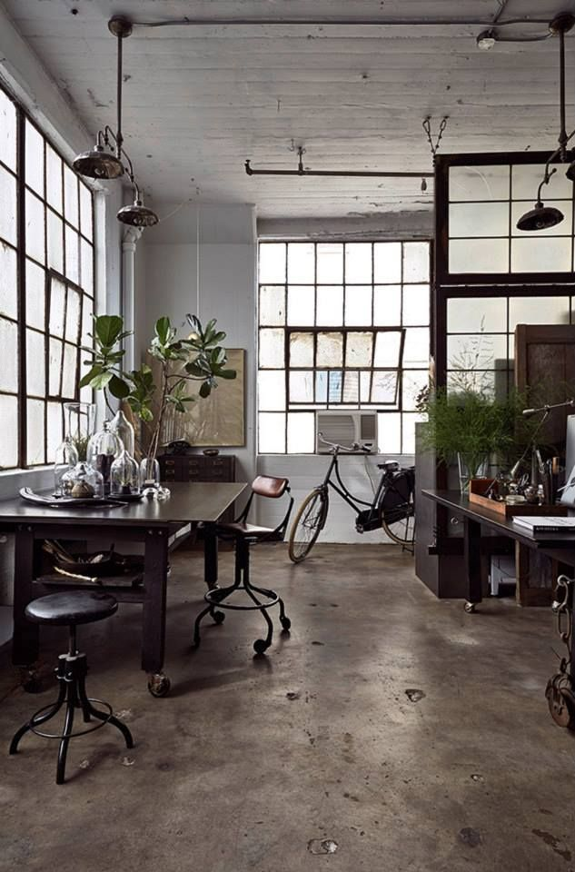 concrete, black window frames, black furniture, factory windows