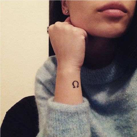 Small Tattoos for Women – Best Tattoo Designs for Women-Lotus- A unique twist on traditional flower ink. Find a tattoo the describes your personality at redbookmag.com.
