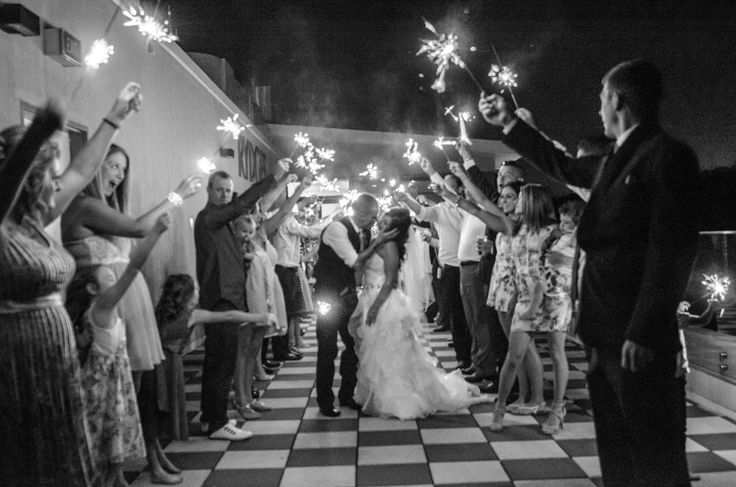 Candid Photos of a Lifetime - So much fun - getting all the guests to help light up the path for the newlyweds, with long stemmed sparklers  www.candidphotosofalifetime.com.au
