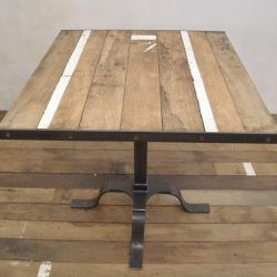 Small, square handcrafted industrial table, reclaimed wood top and metal legs. Loft style. Retro design. Restaurant table.