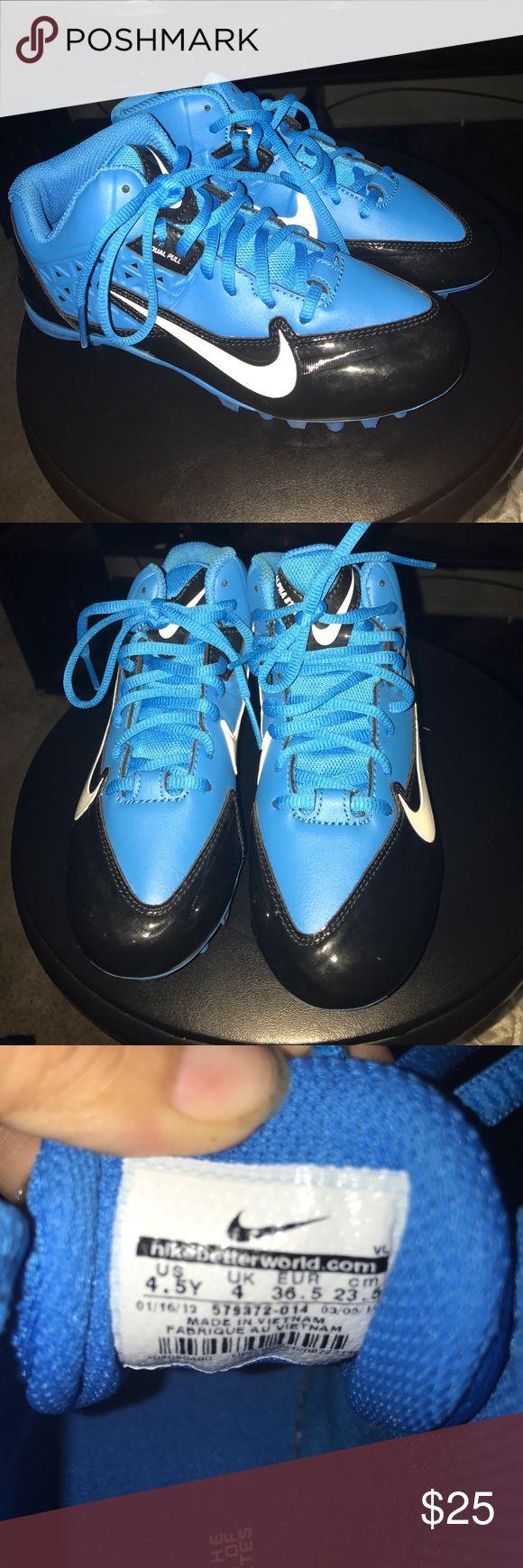 Nike alpha strike cleats Blue and black Nike alpha strike youth cleats , size 4.5 youth. NWOT, never worn . Football cleats Nike Other