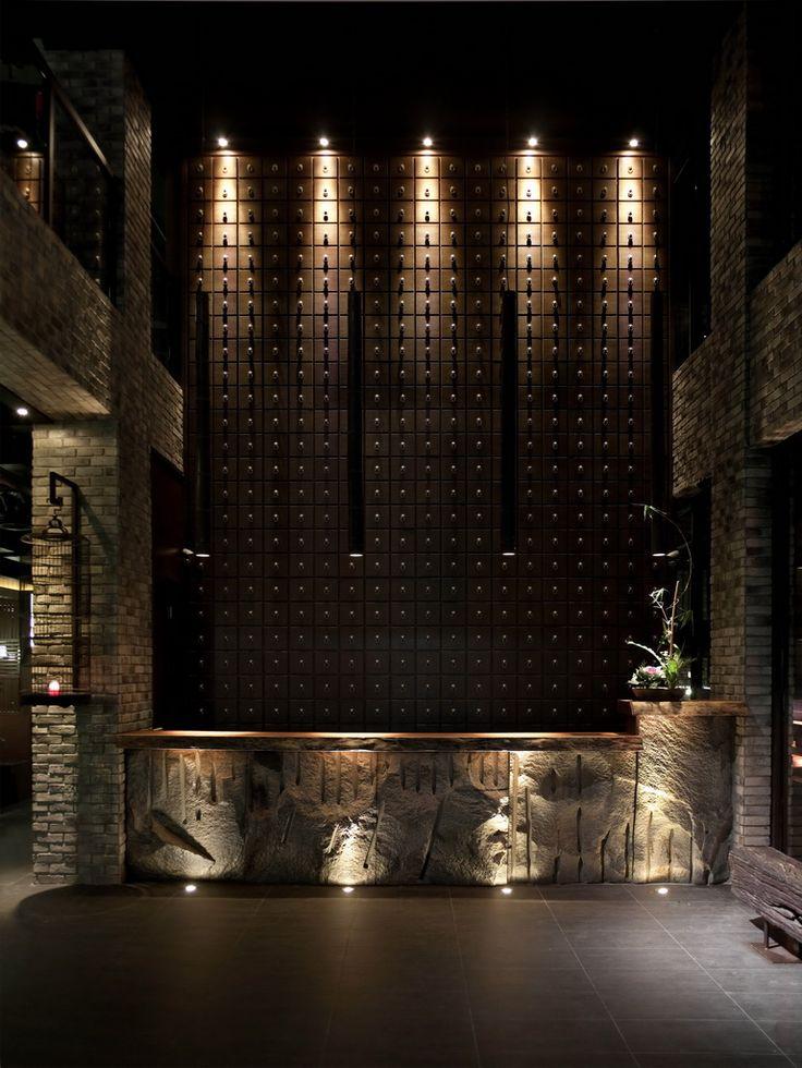 wood accent wall, drama, natural stone, dark lobby