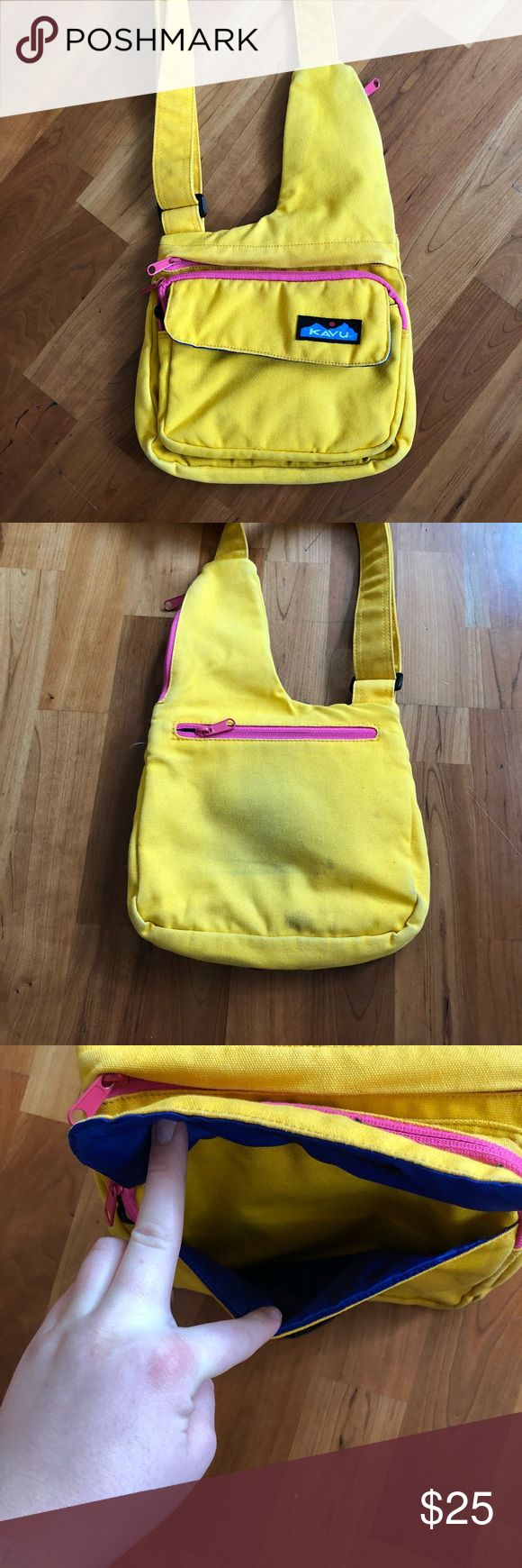 {Kavu} Seattle Sling Kavu Seattle sling in yellow with pink detailing. Good condition, the only wear on this bag is blue on the back from rubbing against jeans. But obviously you won't notice it while it's on. This is an amazing travel bag with its 3 main compartments, pockets galore and a sunglasses holder. It holds everything you need and keeps you organized while you adventure. Kavu Bags