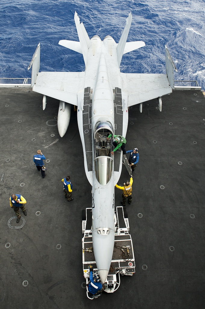 A fighter jet park on the deck on aircraft carrier!