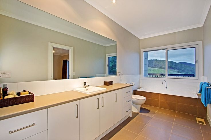 Image the views achieved on a Sloping block. This bathroom leaves nothing to the imagination. A minimalist and cosy design was perfect for this space.