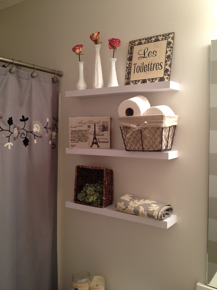 Simple shelves near vanity for extra storage when guests are here