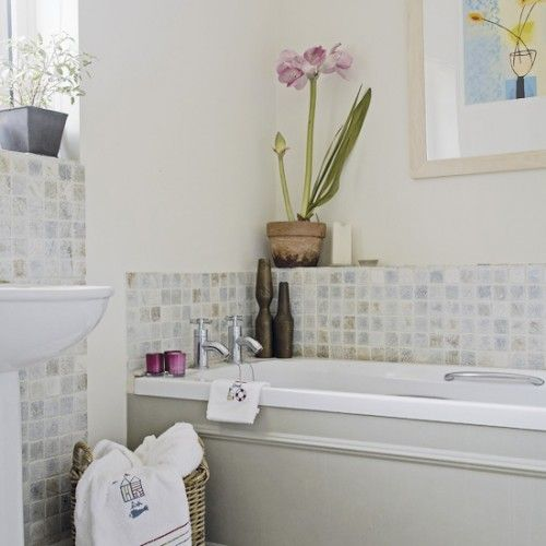 Neutral wall and floor tiles combined with simple bathroom fittings create a classic look in this bathroom.