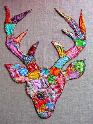patchwork-embroidered deer  breezeway want!  colors could be more muted, but these are fine, too!