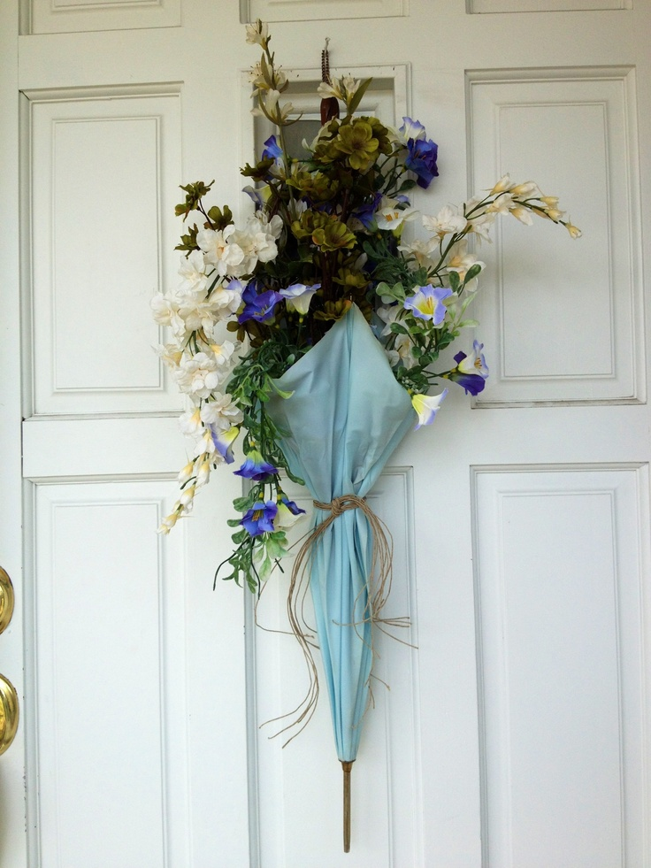 Old umbrella + thrift store flowers= amazing spring wreath!  Thank you pinterest for the original idea!