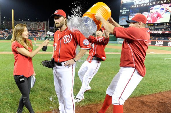 Jayson Werth #28 of the Washington Nationals gets doused with Gatorade by Bryce Harper #34 and Craig Stammen #35 after a 8-5 victory against the Philadelphia Phillies at Nationals Park on August 10, 2013 in Washington, DC.