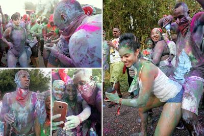 Usain Bolt Gets VERY Close To Revellers At Trinidad Street Party While Covered In PAINT