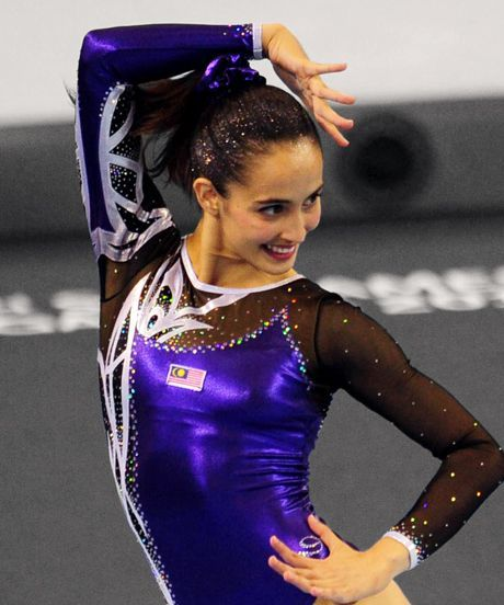 Farah Ann Abdul Hadi Gymnastics Leotard Controversy | Malaysian gymnast Farah Ann Abdul Hadi has sparked controversy among Muslim leaders when she wore a leotard in the Southeast Asia Games. #refinery29 http://www.refinery29.com/2015/06/89463/farah-ann-abdul-hadi-gymnastics-leotard-controversy