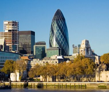 The Gherkin : Swiss Re, London. Nicknamed The Gherkin, the 2004 glass-paneled, rocket-shaped office tower in London's financial center was designed by Norman Foster using 10,000 tons of structural steel.