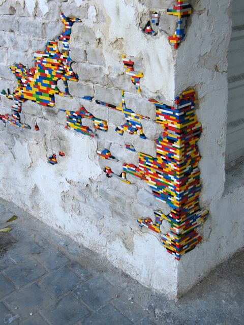 Dispatchwork  Dispatchwork is a project that was started by artist Jan Vormann that has expanded all around the world. People fill in holes and cracks in walls with Legos. It's sort of like guerrilla renovation. Below is a great photo from the Dispatchwork project in Tel Aviv.