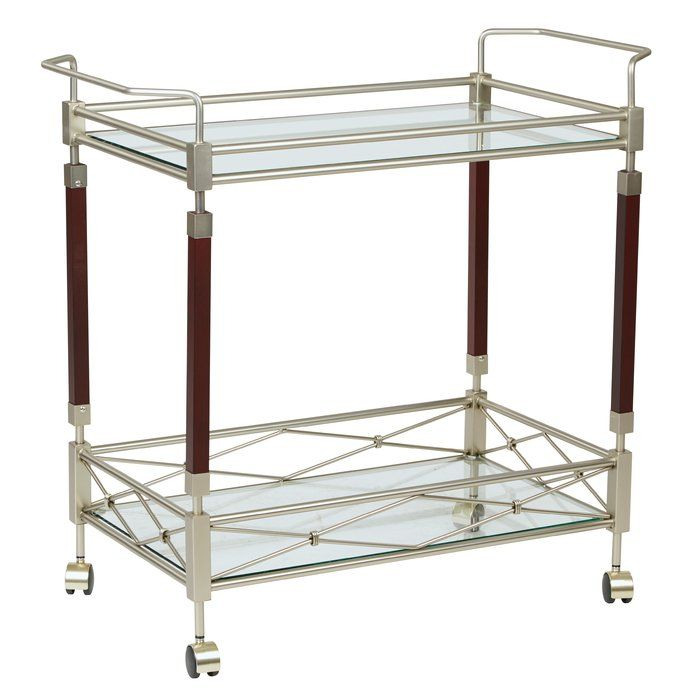 Round out your kitchen ensemble with this sleek serving cart. The diamond details give it an au courant twist, while the tempered glass shelves and wood accents make it an elegant statement piece.