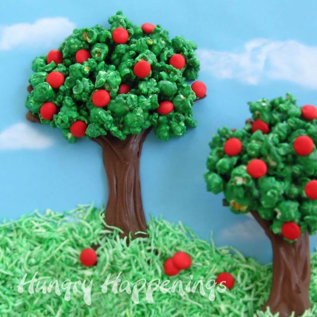 Earth Day Popcorn Trees | a tasty treat to celebrate Earth Day.  Popcorn kernels are coated in green colored white chocolate to create the leaves while candy buttons resemble brightly colored fruit.  The top of a tree is attached to a chocolate trunk.  If you don't have time to plant a tree for Earth Day, you can at least make an edible one. - Foodista.com