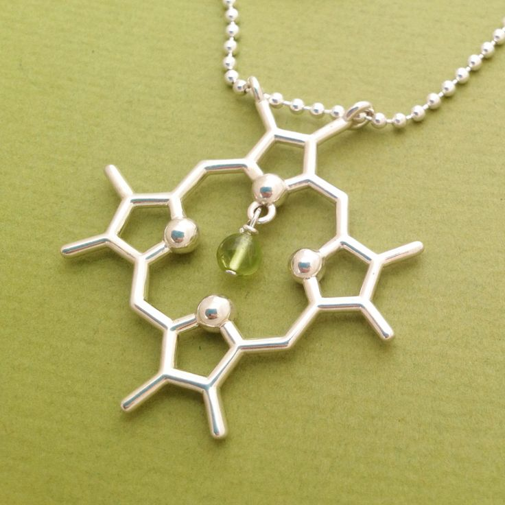 chlorophyll molecule necklace with peridot (140.00 USD) by molecularmuse