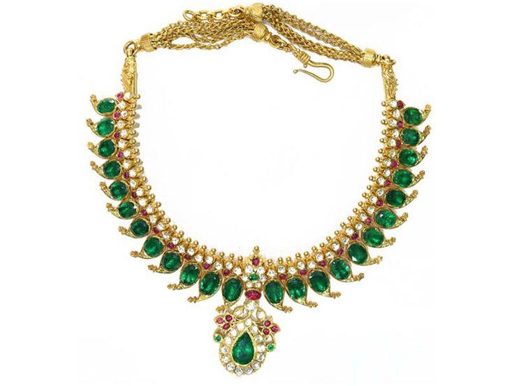 Mango Mala studded with natural emeralds, rose-cut diamonds and rubies, from Karni Jewellers.