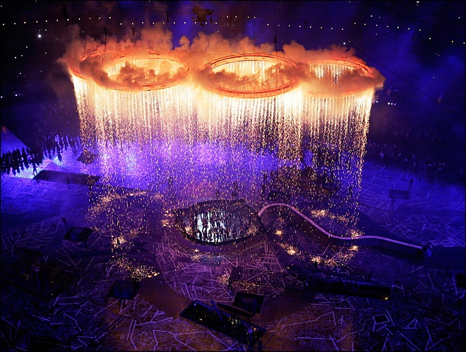 The Olympic rings light up the stadium during the Opening Ceremony at the 2012 Summer Olympics, Friday, July 27, 2012, in London.