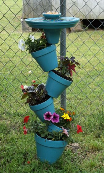 My version of the clay pot planter/bird bath.  I changed the top so it is now a bird bath and a bird feeder.  The birds are loving it so far!