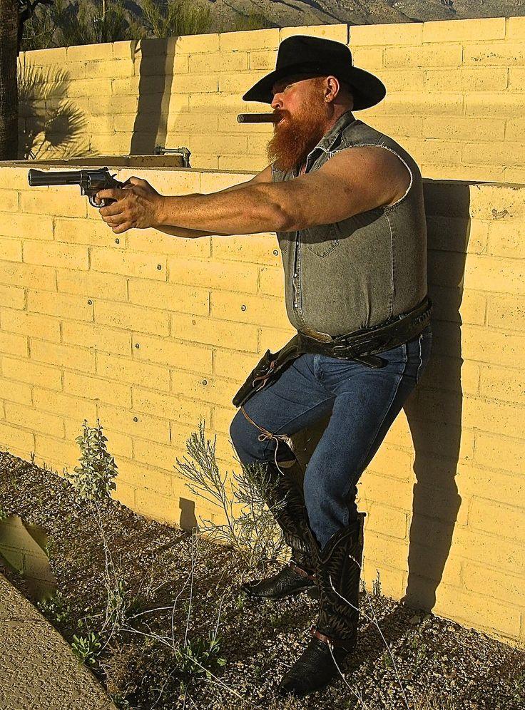 https://flic.kr/p/e4jsAW | Armed Cigar Cowboy | Cigar smoking, Paul Bond Boots, spurs, muscle bear, cowboy, pistol, taking aim