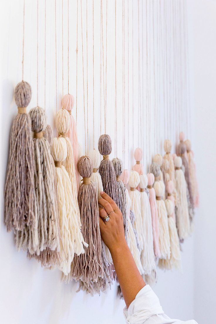 When searching for the perfect thing to fill the empty wall beside her staircase, Honestly WTF blogger Erica Chan Coffman discovered that the stunning tassel wall hanging of her dreams was actually shockingly simple to DIY.
