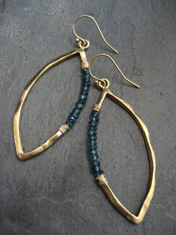 These marquis earrings are cast in sterling silver and finished to an uneven surface followed by a soft semi-matte 14k gold plating. Beautiful blue