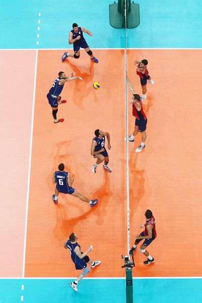 Osmany Juantorena Photos - Osmany Juantorena of Italy spikes against the United States during the Men's Volleyball Semifinal match on Day 14 of the Rio 2016 Olympic Games at the Maracanazinho on August 19, 2016 in Rio de Janeiro, Brazil. - Volleyball - Olympics: Day 14