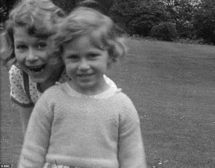 As close as two sisters could ever be: Elizabeth, left, and Margaret were never happier th...