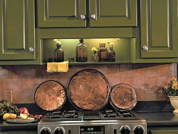 Choose two colors for your checkerboard tile pattern. We chose a metallic copper for our base and a creamy neutral for our topcoat. Use a brush to paint the entire wall surface with the copper-colored basecoat. Allow to dry. Then, using a ruler, mark off squares with a pencil. Make your squares as big or as small as you like.