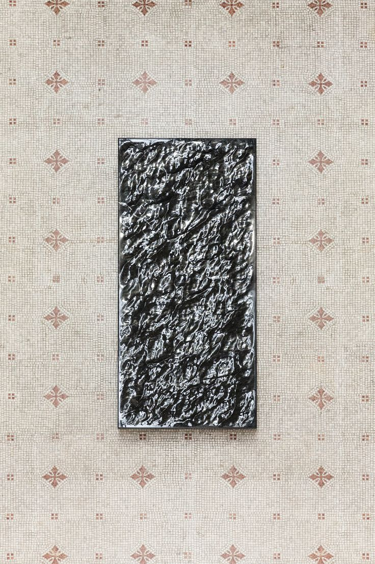 as mersmerizing as watching calm waves, mathieu lehanneur's 'liquid marble' reflects and distorts itself, using the intense dark stone to accentuate depth, mystery and awe.
